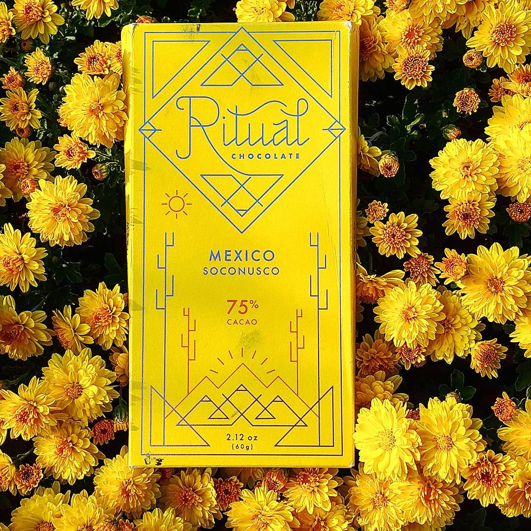 ritual soconusco mexico 75 dark chocolate bar flowers front of bar