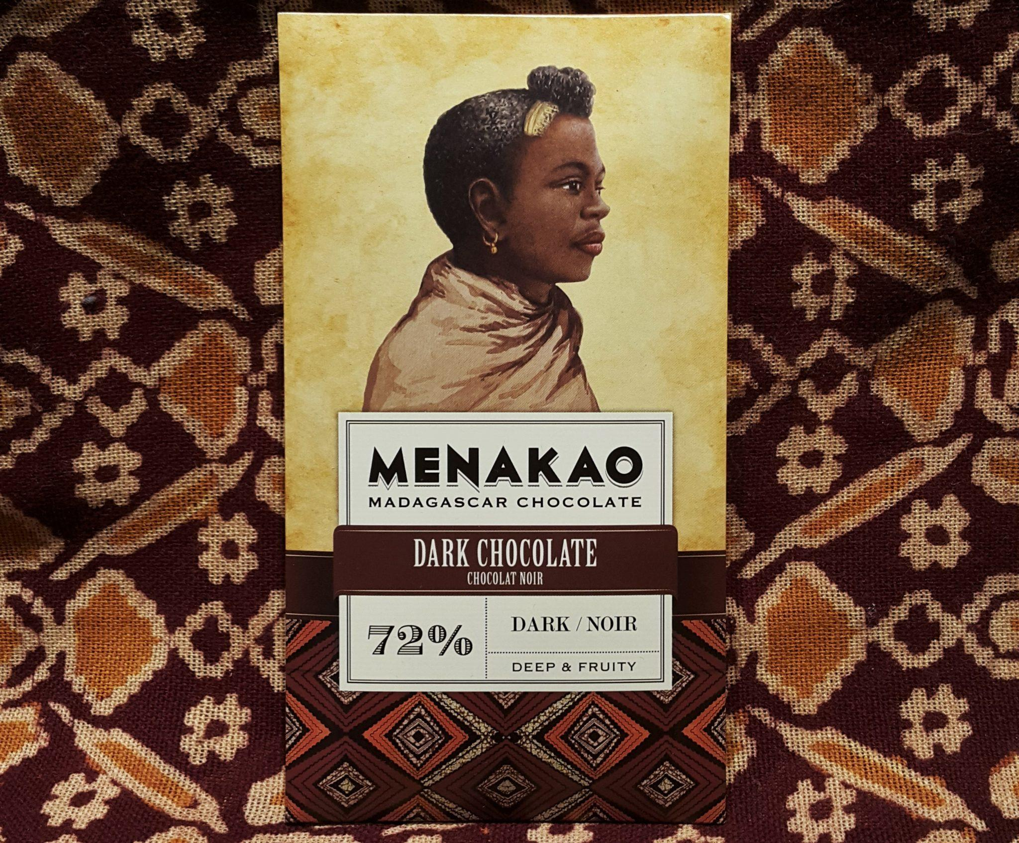Menakao Madagascan Chocolate 72% Dark Front of Bar Packaging on Top of Orange Fabric