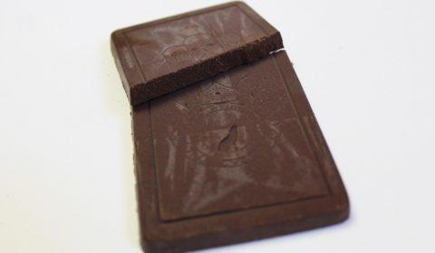 Craft Chocolate Review Wild Omen Mesquite Raw Chocolate Front of Bar Closeup