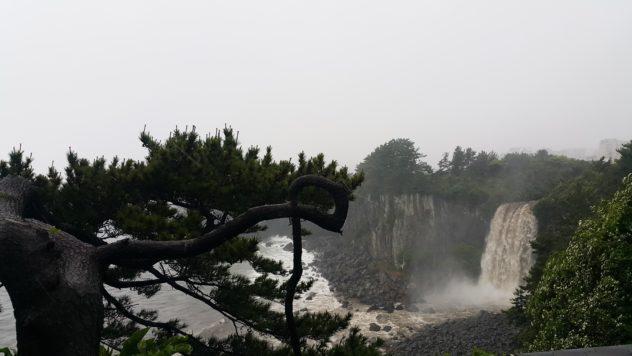 Jeongbang Waterfall, unfortunately sans rainbow, here.   #travel #korea #jeju #island #itinerary