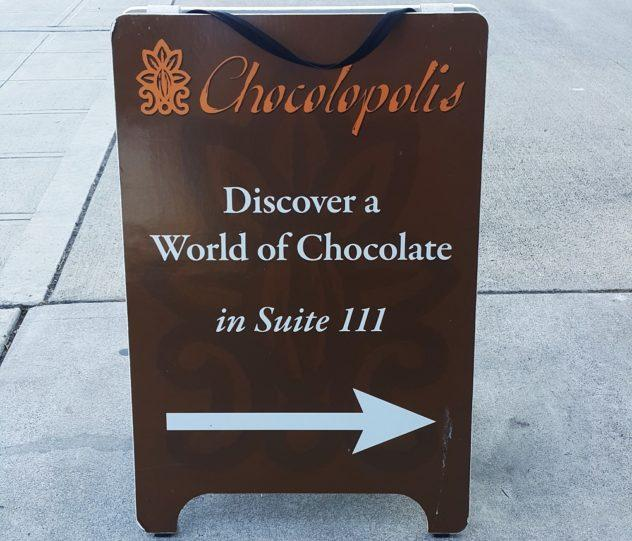 Complete Seattle Chocolate Guide Chocolopolis Outside Sign. From melty chocolate truffles to full-blown chocolate factories, check out 17 can't-miss chocolate stops in Seattle, Washington. | #chocolate #chocolat #guide #craft #bean #to #ar #wine #beantobar #seattle #foodie #foodies #america #travel #truffles #chocolatiers #cafes